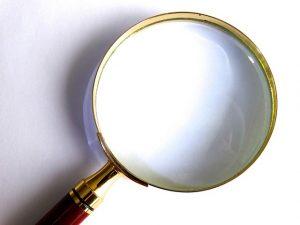 self-examination, magnifying glass